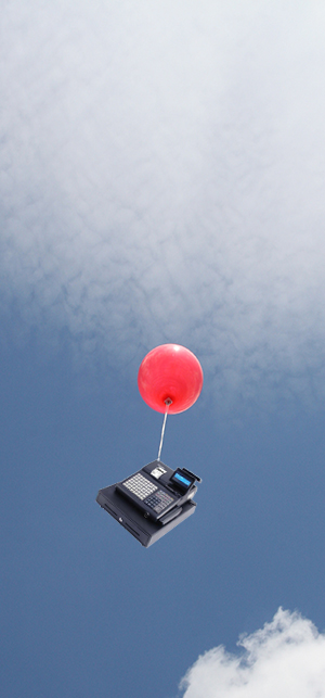 A cash register being pulled into the sky by a balloon.